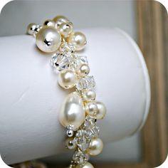 Hey, I found this really awesome Etsy listing at https://www.etsy.com/listing/101942660/pearl-bridal-bracelet-swarovski-crystal