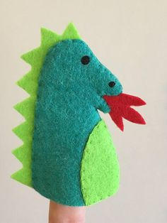 Set of 4 finger puppets taken from classic fairy tales.  Includes a princess, a fire breathing dragon, a knight and his horse. Each handmade from soft felt with a cushioned head.  This is a perfect gift for kids to add interactive fun to story time and play time. Lovingly hand cut,