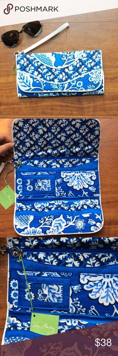 NWT Vera Bradley Blue Lagoon Clutch Authentic Vera Bradley.  Blue lagoon canvas print with white leather trimmed.  This Clutch features 8 credit card 💳 slots, an ID pocket and back zip pocket.  There is a minor discoloration on the front left corner.  Length 10 in, height 5 in. Vera Bradley Bags Clutches & Wristlets
