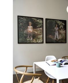 Wishbone chair, check. Eames shell chair, check. Oversized square photography of the kids, check. Pretty great!    Interior photography by Bieke Claessens