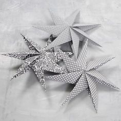 Seitsensakarainen tähti neliöpaperista
