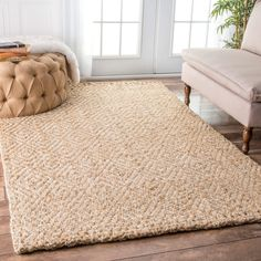 This lovely flatwoven jute rug adds contemporary elegance to your home space. Braided fiber lengths are stitched into a jagged diamond pattern. This rug is ideal for any contemporary or casual setting.