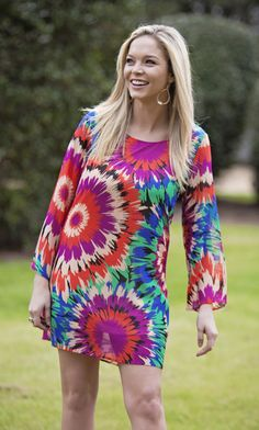 Spring Bliss $66.00  Spring Bliss is a beautifully patterned dress with a criss-cross in the back.  Model is in a size small. Fully Lined.  Women's Fashion, New Arrivals, Spring look, Style, Spring Dress