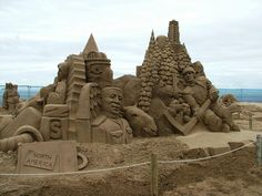 Sand sculpture: North America (front) ... hockey player, totem, Mountie, pine trees #art @ UK competition in Weston