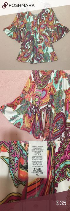 "⭐️New Inventory⭐️ Paisley bell sleeve top I just got this new top in. Cute Bell sleeve paisley top. Elastic neckline. Bright colors: pinks, teal, orange and many more. Would be perfect for those summer vacations.⛱.    XL= 24""long, 21"" long sleeve,22"" across the bust. ⭐️ 2X= 24 1/2"" long, 21"" long sleeve, 23"" across the bust⭐️ 3X= 25 1/2"" long, 22"" long sleeve, 25"" across the bust.⭐️ Tops"