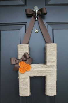Monogram wreath ... Cute for the front door, instead of a round wreath (non holidays) by alta