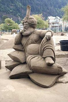 Genie sand sculpture. Amazing they can make the headpiece stand so tall without breaking,
