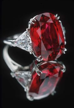 ruby ring with trillion diamonds.what a beauty! This would be my engagement ringOval ruby ring with trillion diamonds.what a beauty! This would be my engagement ring Ruby Jewelry, Jewelry Rings, Jewelry Accessories, Fine Jewelry, Cheap Jewelry, Jewelry Shop, Fashion Jewelry, Selling Jewelry, Jewelry Design