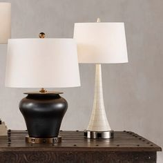he gentle downward slope of the Snowdrift Table Lamp from Currey and Company cuts a gracious silhouette. The body and the finial are clad in slices of bone that create a textural interplay of creamy tones. The ivory lamp is topped with an off-white shantung shade.