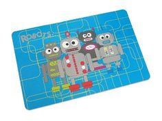 Salvamantel de plástico con un original diseño de robots.  www.tatamba.com