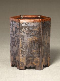 Hexagonal pen stand with a design of longevity animal and plant. Joseon Dynasty, 19th century. Joseon. inlayed lead on the iron ground. 12.1...