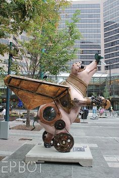 via EPBOT: giant freakin' steampunk flying pig statue!  i need one of these for my front lawn.