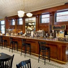 Featured Image:  Vintage inspired commerical bar.   At Carriage Barn Custom Builders we create stunning custom bars and entertainment units.  Custom designed cabinets, finishes and details.