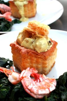 Vol-au-vent with Salmon cooked in Coconut Milk, served with Spinach and Prawns.