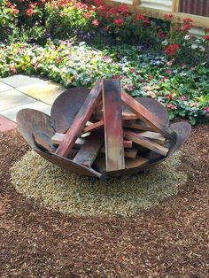 Welded blades from tractor plow are turned into a wonderfully rustic firepit!