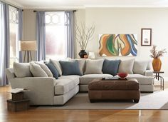 Matthew Living Room - Cushioned for ultimate comfort, the Matthew 3-piece sectional is a fashionable and kid-friendly family room centerpiece. Adorned with plush pillows and accented with blush, leather, wicker and wood, the space achieves a contemporary feel without sacrificing comfort.  Style tip: A classic leather ottoman adds a little sophistication to family room furniture.