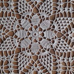 Doily By Artistic NeedleWork I like square things. They fit almost any space. This pattern turned out really pretty! Its simple and the perfect size for just about anywhere in your house. Could also be used as a place mat for luncheon sized plates. This piece is newly made in