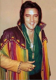 ♡♥Elvis looks good in a green shirt wearing gold & diamonds and a colorful leather Indian jacket!♥♡ LOVE THIS JACKET IT IS ONE OF MY FAVORITE