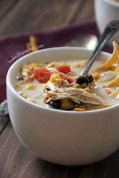 Slow Cooker Chicken Enchilada Soup Recipe from bakedbyrachel.com# slow cooker healthy recipes