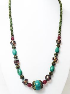 Beautiful handcrafted boho necklace made with a combination of different type of beads. Perfect for a casual wear. Materiales:12mm turquoise beads. 4mm red czech crystal brown czech beads brass metal #longbeadednecklacered