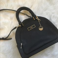 DKNY Saffiano Bowler Structured Bag Beautiful like new authentic DKNY black saffiano leather bowler too handle bag with gold hardware and detachable shoulder strap. No marks in perfect condition DKNY Bags Shoulder Bags