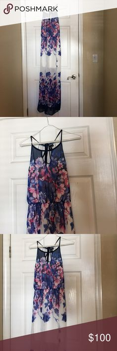 Long Floral Dress Cute white and Floral dress • size small • true to size • good condition • dress has a lining • 100% polyester• slit on one side as shown in photo• ties in the back at the top • absolutely stunning    • Offers Welcome • Bundle Discounts  • Suggested User • Fast Shipper Windsor Dresses
