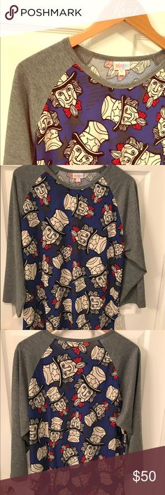 """Lularoe Uncle Same Americana Randy, SO FUN! This adorable, patriotic Uncle Sam Randy is sure to put a smile on your face every time you wear it! Heathered gray sleeve, vibrant blue body, dark gray stars in the background. Uncle Sam is a true white w/ black outline, and the red bow tie is the perfect pop of color! The 3X Randy's are very limited and hard to find! Super soft and lightweight, you won't be too hot in this! 30""""L, 24"""" sleeve, 24"""" armpit👉🏻armpit. I LOVE the Randy paired with a…"""