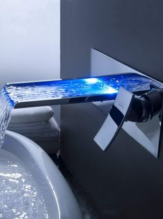 Bathroom, Wonderful Blue LED Lighting In Large Wall Mount Waterfall Faucet Plus Stainless Steel Material And White Tub Plus Towel For Ultramodern Home Bathroom Design Ideas: Plush Bathroom Faucet Design in Chilly Place Bathroom Gadgets, Bathroom Sink Faucets, Bathroom Fixtures, Sinks, Bathroom Wall, Plumbing Fixtures, Shower Faucet, Bathroom Interior, Modern Bathroom