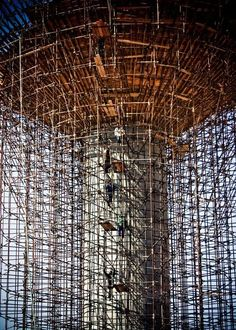 Scaffolding is a temporary structure used to support people and material in the construction or repair of buildings and other large structures. That's a lot of Damn scaffold