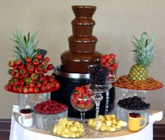 Chocolate fountain idea with strawberries and other fruits. Will have a wedding cake and this!