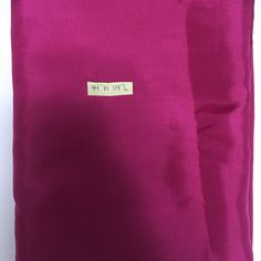 "44"" wide 114"" long (3.16 yards) magenta lining fabric. Location orange crate 2."