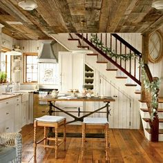The island was a roadside find made of cast iron and wood. The reclaimed pumpkin pine (a wood named for the orange hue that develops after a century or more of oxidation) on the floors also trims the Carrera marble countertops.