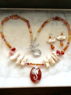 Carnelian, Swarovski Crystals, Freshwater Stick Pearls, adorable silver tone seahorse! Matching earrings. $30/set