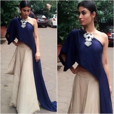 Mouni Roy attended an event earlier today looking lovely in Ezra. Her midnight blue dipped drape top was paired with a beige skirt and styled with a . Stylish Dresses, Nice Dresses, Fashion Dresses, Indian Dresses, Indian Outfits, Ethnic Outfits, Lehenga Designs, Zara, Bollywood Fashion