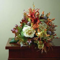 A fusion of fall colors and textures. Floral design by David Lavoy. Photo by Lauren Rubinstein