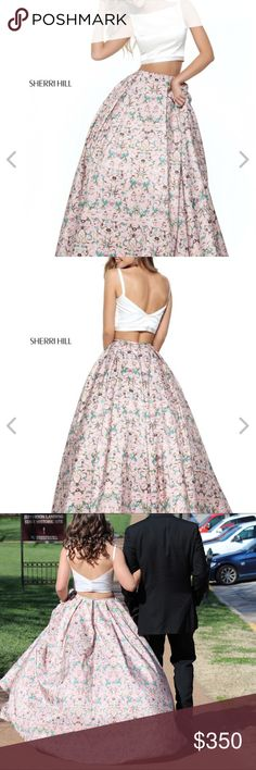 Light Pink Sherri Hill prom dress Ball down style prom dress. It is light pink with a pattern. It has blue and purple in it. There are 3 layers underneath to give it volume. It has pockets. Size 2! Make an offer! Sherri Hill Dresses Prom