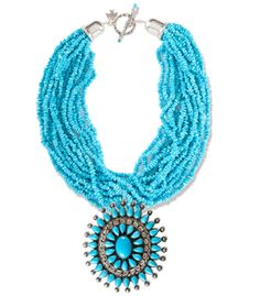 Lovely multi strand necklace made of tiny turquoise beads with elaborate silver and turquoise pendant/pin.