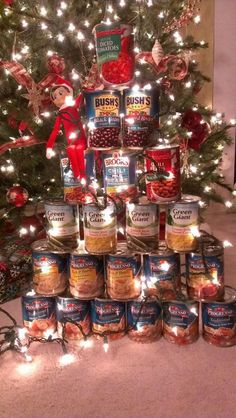 """Host a Food Drive. This can be done with a church or community group or we like this family idea – Elf with a note that says, """"Let's take these to the food bank!"""" plus 25 Christmas Traditions to Start Right Now on Frugal Coupon Living! Noel Christmas, All Things Christmas, Christmas Holidays, Christmas Crafts, Christmas Ideas, Happy Holidays, Elf On The Shelf, Shelf Elf, L Elf"""