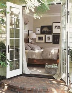 love love love this. love the french doors opening onto the brick patio.