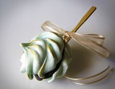 Cookies on a Stick! - Two massive gooey meringues sandwiched with dark Belgian Chocolate accented it in gold