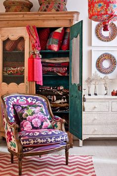 Such vibrant colors - even though this is a store display, I still love the beautiful armoire holding colorful quilts!