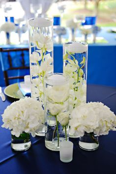 Centerpieces a plenty. simple hydrangeas, then submerged beneath floating candles: mini cymbidium orchid stem, dendrobium orchid stem and spray roses. Submerged Centerpiece, White Flower Centerpieces, Wedding Centerpieces, Wedding Table, Floating Flowers, Floating Candles, Decoration Table, Reception Decorations, Wedding Arrangements