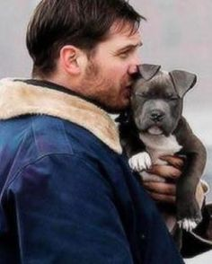 Tom Hardy snuggling dogs is the best thing you'll see all WEEK.