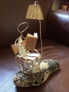 Reading woman sitting on a comfortable chair, papier mache sculpture, – Reading the woman sits on a comfortable paper mache chair Etsy – – BuzzTMZ Wire Crafts, Diy And Crafts, Arts And Crafts, Newspaper Crafts, Book Crafts, Diy Kitchen Shelves, Book Sculpture, Driftwood Art, Wire Art