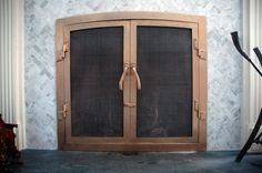 Forged bronze fireplace screen with copper rivets, by BMW Ironworks.