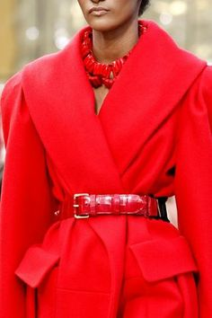Red trench coat, red belt