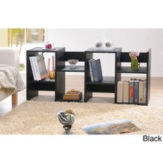 For versatile and decorative storage, try open-backed book shelves. The condensed wood and veneer shelves can be used horizontally or vertically. The open-back design allows a variety of decorating options. The shelves measure 54' x 23.86' x 11.82'.