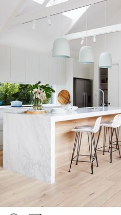 I like the white upper cabinets, and light wood bottom cabinets, white countertops