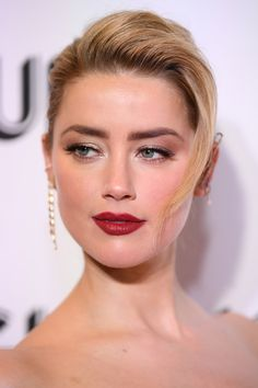 Amber Heard Red Lipstick - Amber Heard finished off her look with a sexy red lip.