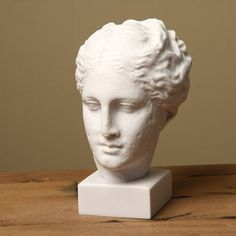 Add a classical feel to a room with this Greek head statue, a detailed reproduction of one from a museum in Greece. Made of primarily marble, it is quite sturdy. This image of a Goddess can add to the elegance and style of many homes.